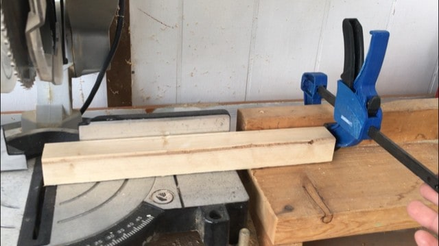 Using a vice clamp on the miter saw fence to act as a template to ensure all cuts are the same length (making a toddler helper stool DIY)