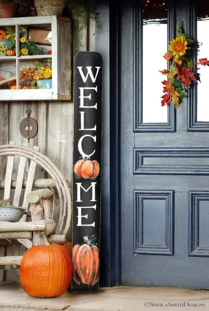 Fall porch decor ideas - welcome signs propped up next to the front door