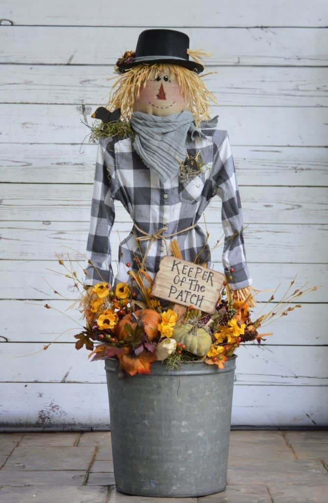 Fall porch decor ideas - scarecrows are one of the fall porch essentials