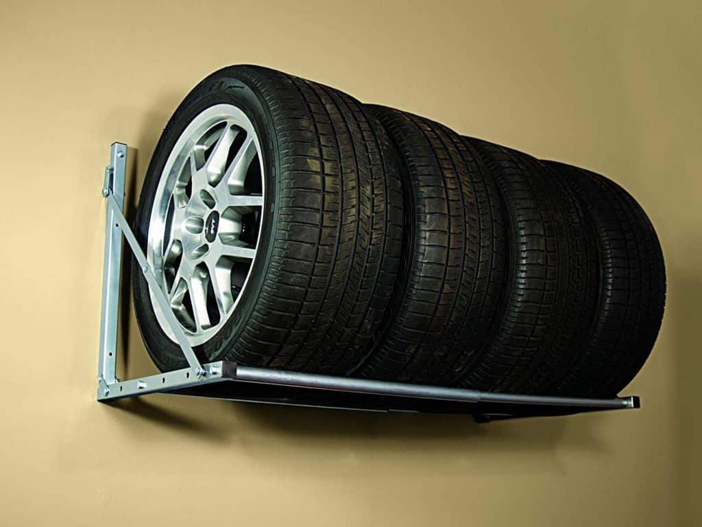 wall mounted tire racks make convenient garage storage ideas