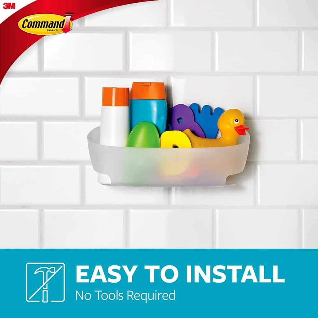 wall mounted shower caddy by Command sticks to the wall without drilling