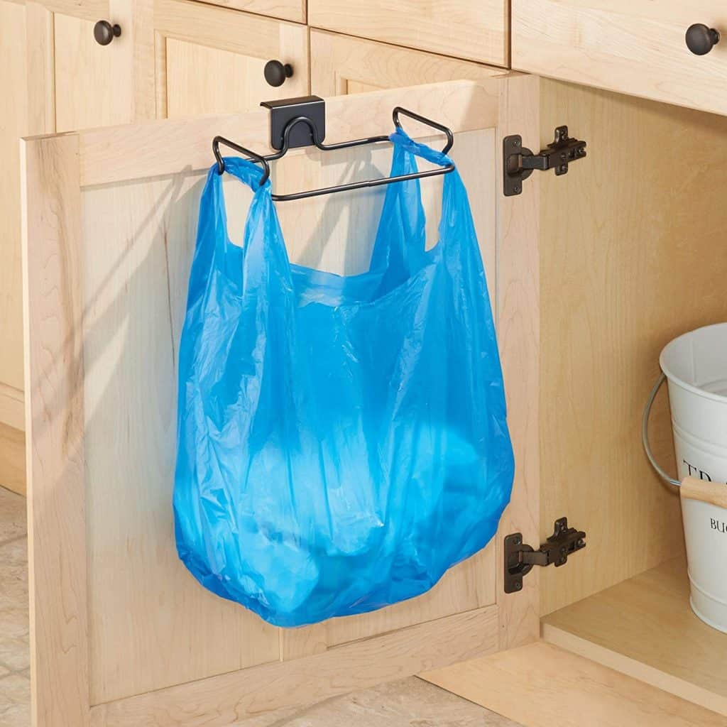 A clever rv organization accessory  - hang garbage bag from cabinet door