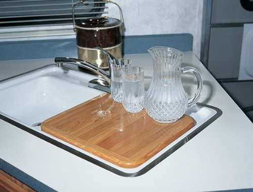 A sink cover is a great rv kitchen organization accessory because it gives you more counter space in your kitchen camper