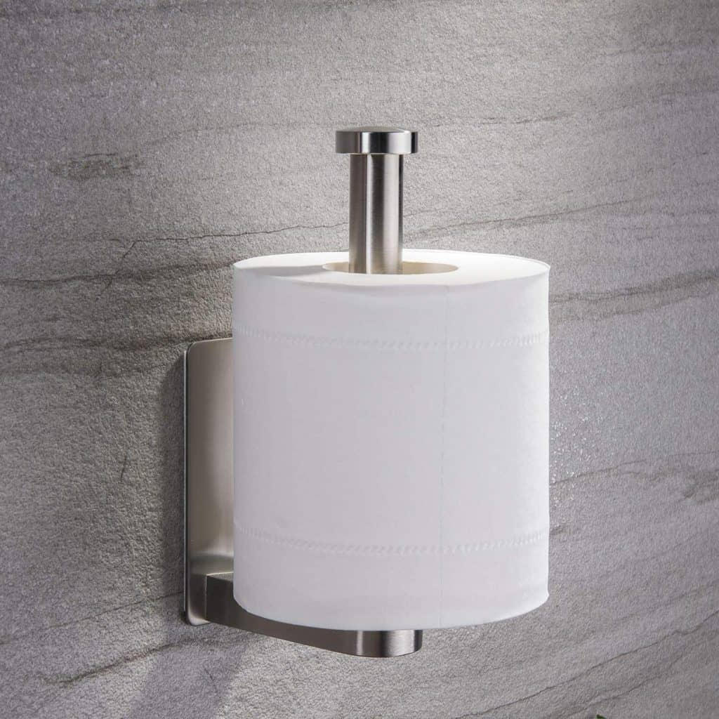 Toilet paper holder sticks to their wall using adhesive. Could make a good RV toilet paper holder.
