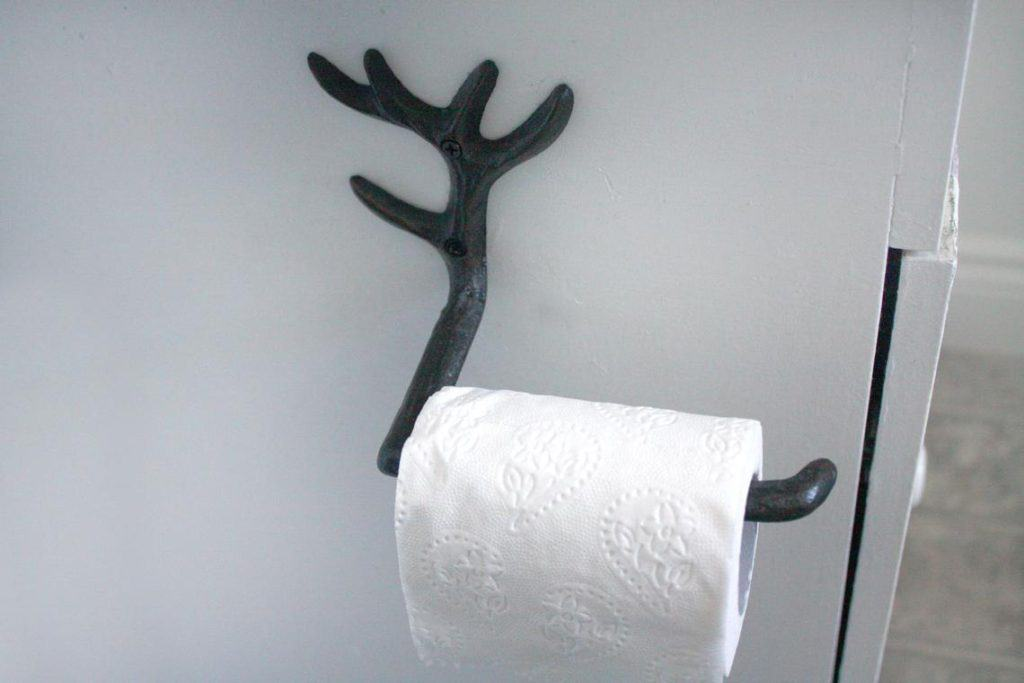 A good toilet paper holder idea for hunters and outdoorsy folks - a cast iron antler toilet paper holder