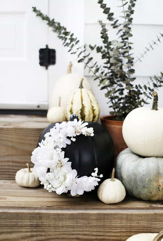 DIY fall decor ideas - a craft pumpkin used as a floral display