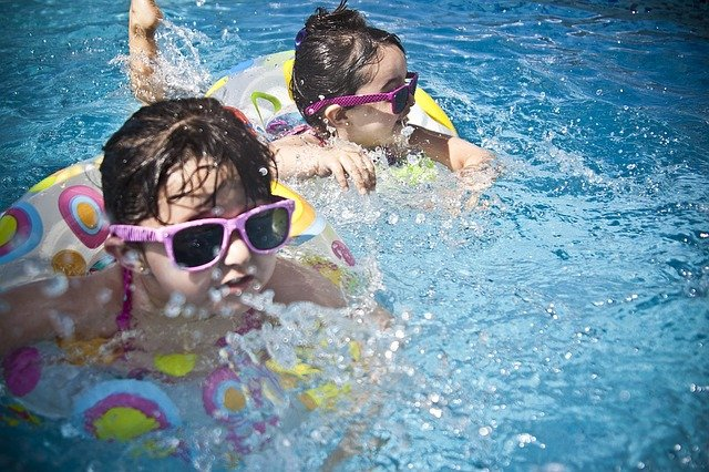 Swimming in an indoor pool is a fun children's winter birthday party ideas.