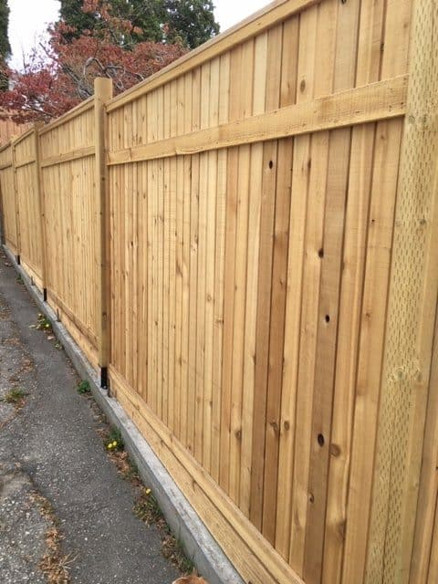 Best Privacy Fence Ideas - these pre-made wood panels can be installed quickly and make a quick privacy fence for your backyard.