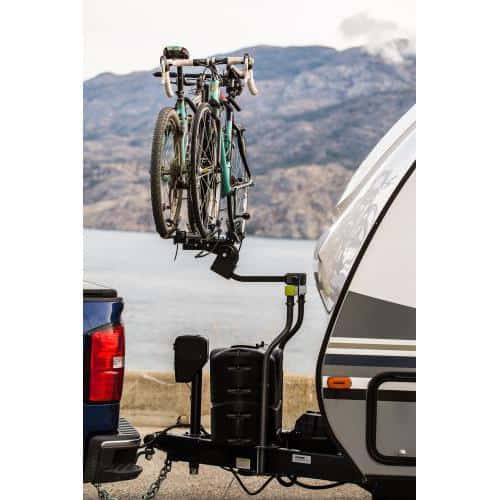RV bike rack attachment called the Straddler by Swagman creates a hitch receiver at the front of your trailer so you can mount a bike rack to it.