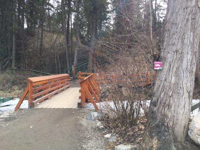 A wooden bridge over the Kokanee Spawning Channel in Mission Creek Regional Park