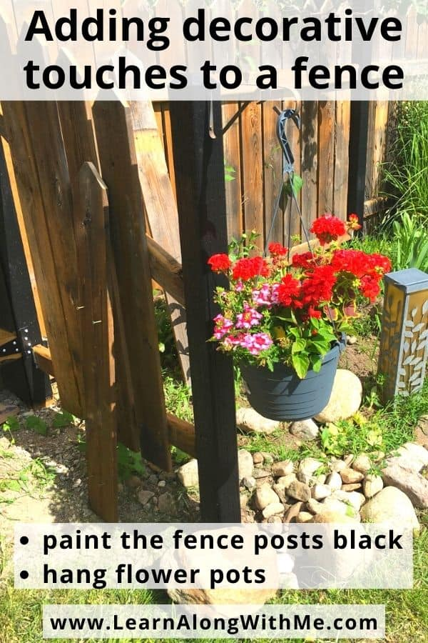 A quick way to make your wooden fence look better is to hang some flower baskets from the fence
