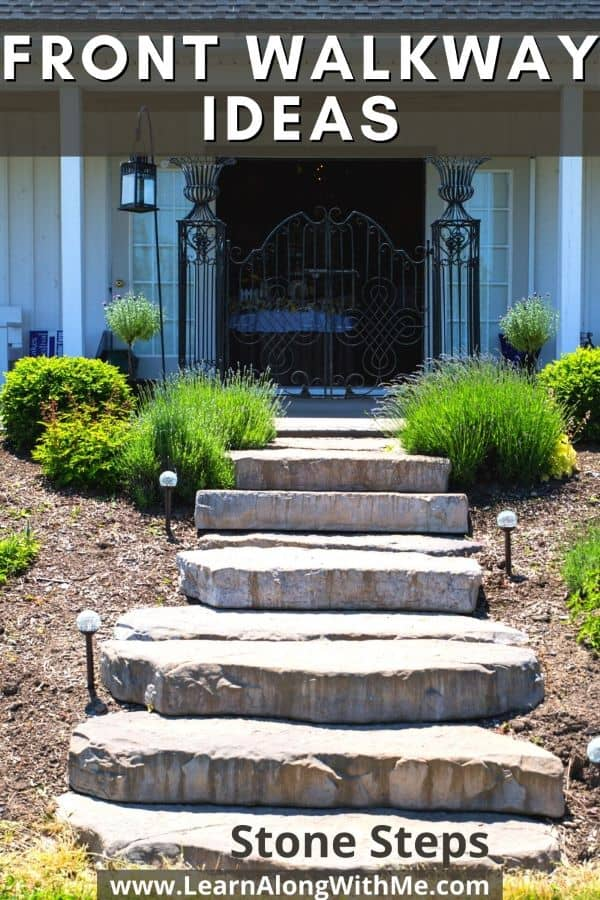 Beautiful front yard landscaping with stone steps, solar lights, bark mulch, ornamental grasses and shrubs.