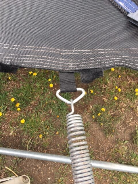 Trampoline repairs - reconnecting the trampoline spring to the trampoline mat v ring.