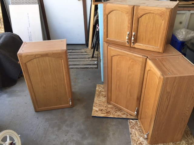 old kitchen cabinets on Facebook Marketplace and I proceeded to remodel them for our laundry room