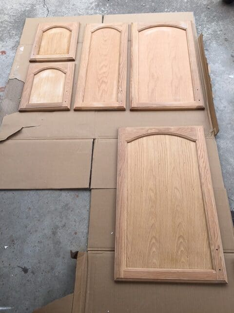 Laundry room cabinets after a light sanding. You want to sand them so the paint sticks better.
