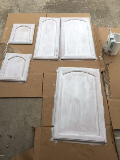 Laundry cabinet doors after being primed with a low VOC primer