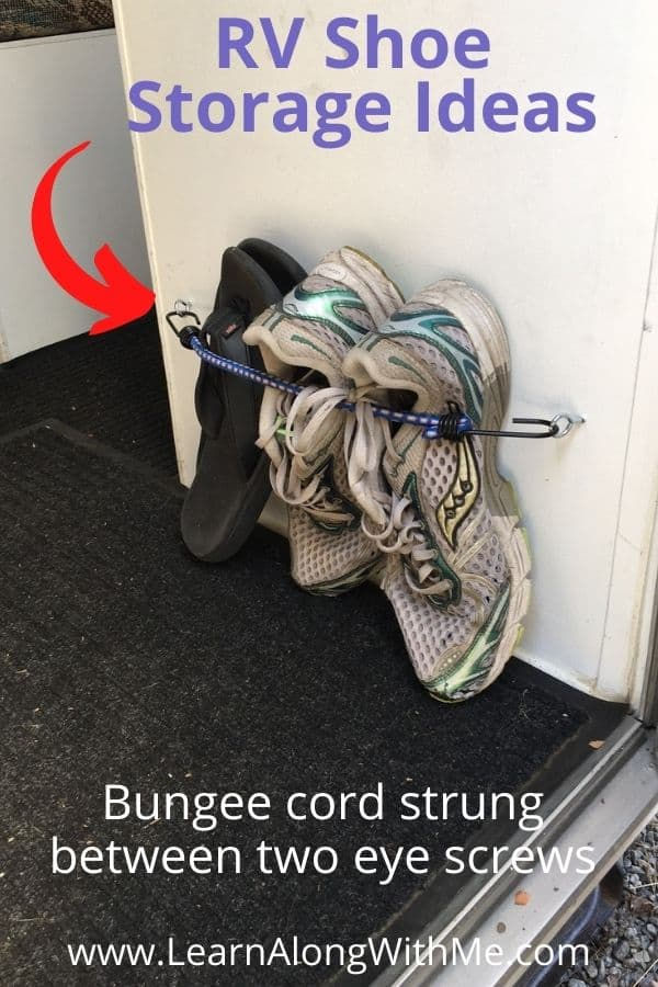 RV shoe storage bungee cord strung between two eye screws. It worked well but you have to be careful what you screw it in to...make sure the cabinet is thick enough to stand up to the stress of the bungee.