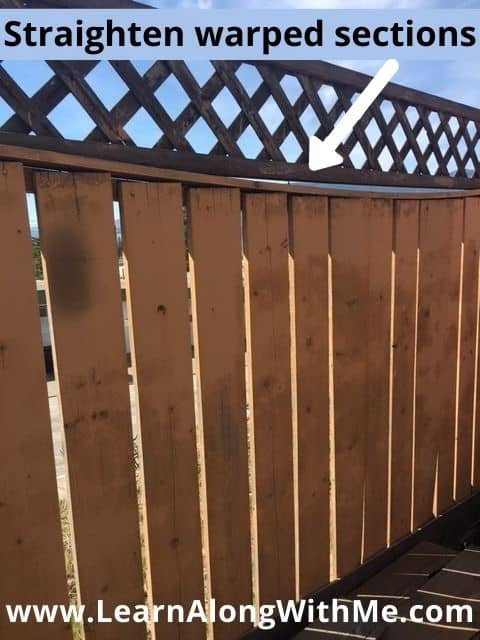 Straighten and fix warped sections of a wooden fence to improve the look of the fence