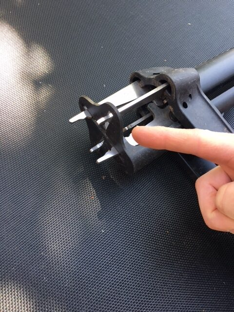 Fiskars weed puller - when you push down on the orange handle this black piece slides down and pushes out the weed