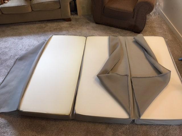 Milliard tri folding mattress with the cover unzipped