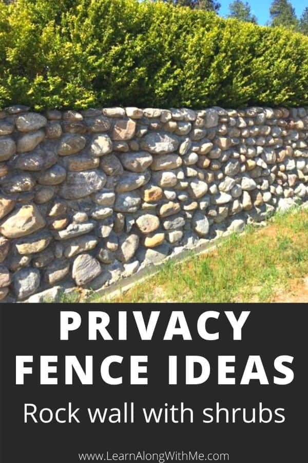 Privacy Fence ideas - rock wall with shrubs