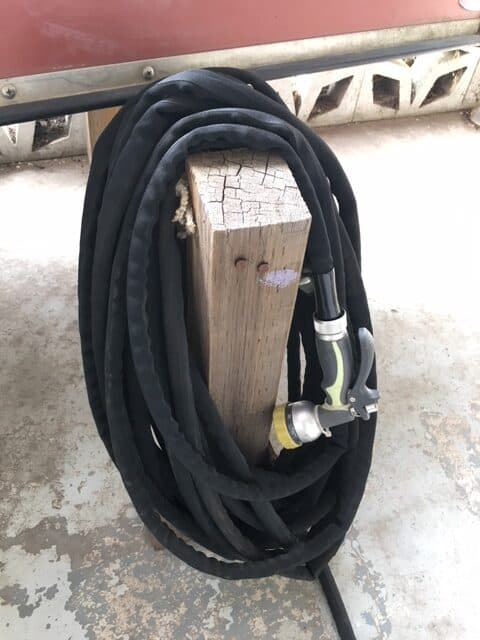 Rapid Flo garden hose stored over my canoe rack. Because it collapses and is lightweight it is easy to store.