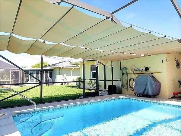 Retractable Pool canopy made by CableShade. It is a good pool shade idea.