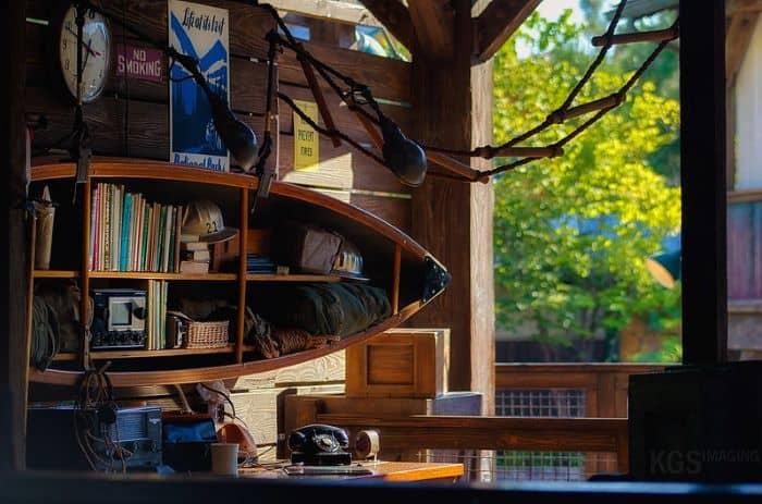 Canoe Bookshelf ideas  - horizontal canoe bookshelf.  Image from Flickr