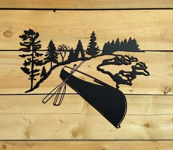 Canoe wall decor - a metal sign featuring a canoe image that can be cut from aluminum or mild steel. It is available on Etsy