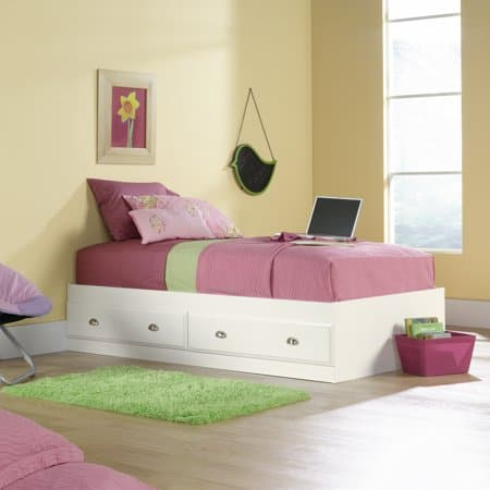 White twin bed with 2 storage drawers underneath.