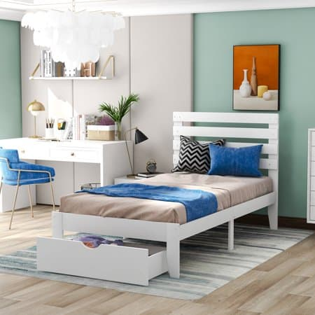 White twin bed with storage drawer underneath