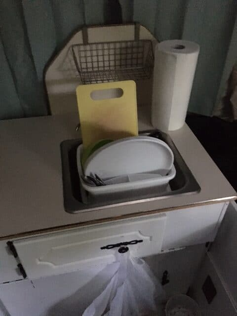 Camco dish drying rack in the sink of our Palomino colt pop up camper