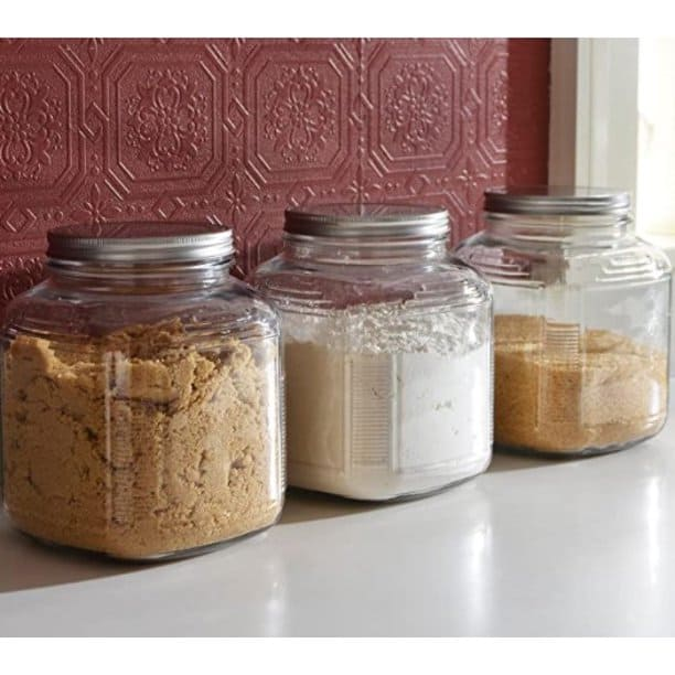 These one gallon glass jars by anchor hocking make a good rice storage container. They feature a screw on lid.